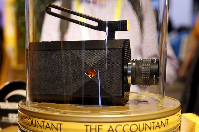 A prototype Super 8 film movie camera with electronic viewfinder is displayed in the Kodak booth during the 2016 CES trade show in Las Vegas, Nevada January 8, 2016. The retro-styled camera is expected be on the market by the end of the year, a representative said. (Photo by Steve Marcus/Reuters)
