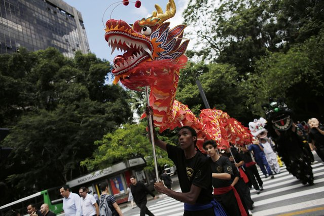 Performers present a dragon dance during Chinese Lunar New Year celebrations in Sao Paulo February 19, 2015. (Photo by Nacho Doce/Reuters)