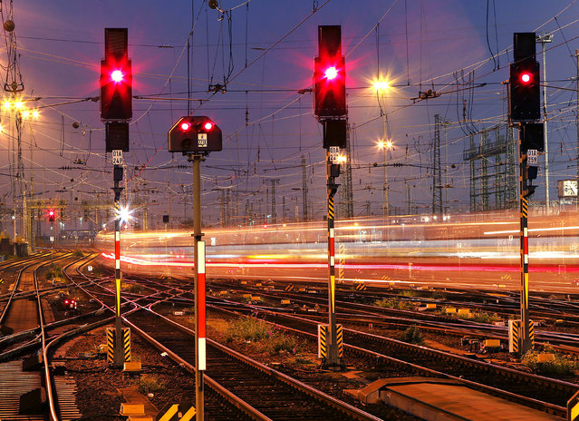 In this Wednesday, October 17, 2018 file photo a train leaves at night the main train station in Frankfurt, Germany. Four European rail companies announced Tuesday they plan to boost the continent's network of night train connections by reviving routes that were dropped several years ago for cost reasons. (Photo by Michael Probst/AP Photo/File)