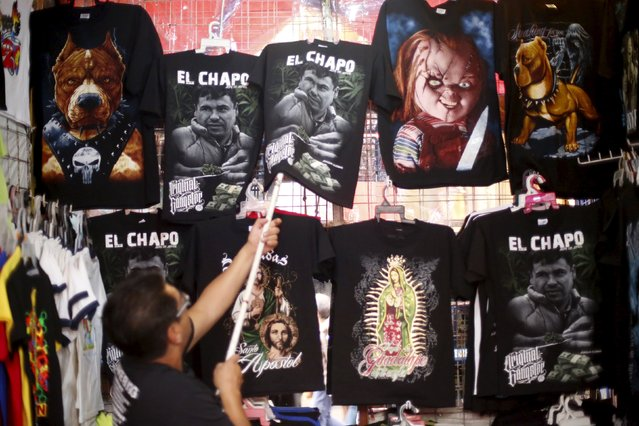 "A seller displays t-shirts with an image of Joaquin ""El Chapo"" Guzman for sale in a market in Tepito neighborhood in Mexico City, Mexico, January 25, 2016. (Photo by Edgard Garrido/Reuters)"