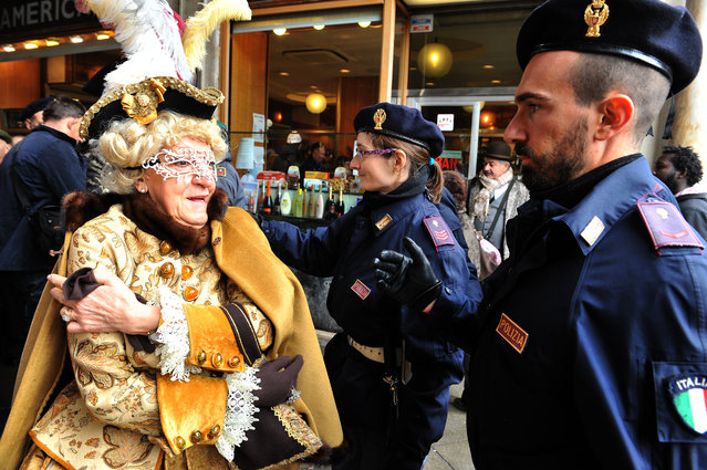 A masked woman goes through a security check in Venice, Italy, Sunday, January 30, 2016. (Photo by Luigi Costantini/AP Photo)