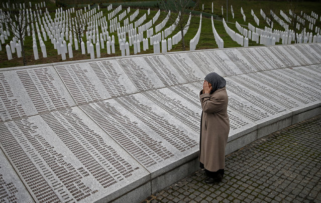 BOSNIA AND HERZEGOVINA: Bida Smajlovic, prays near the Memorial plaque with names of killed in Srebrenica massacre before watching the Trial in Hague Tribunal, in Potocari near Srebrenica, Bosnia and Herzegovina March 24, 2016. Bida lost her husband and brother, and dozens members of family. (Photo by Dado Ruvic/Reuters)