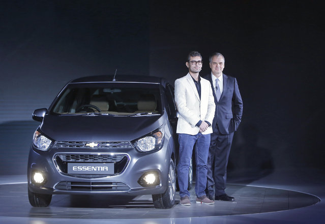 Stefan Jacoby (R), General Motors (GM) International President and Harish Kumar, Creative Designer GM North America, pose with their newly launched Essentia car at the Indian Auto Expo in Greater Noida, on the outskirts of New Delhi, India February 3, 2016. (Photo by Anindito Mukherjee/Reuters)