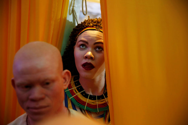 Participants wait back stage before getting on the catwalk during the Mr & Miss Albinism Kenya Beauty Pageant 2018 in Nairobi, Kenya, November 30, 2018. (Photo by Baz Ratner/Reuters)