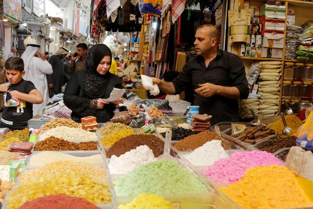 An Iraqi woman shops at a wholesale market ahead of the holy fasting month of Ramadan, in Mosul, Iraq, April 12, 2021. (Photo by Khalid Al-Mousily/Reuters)