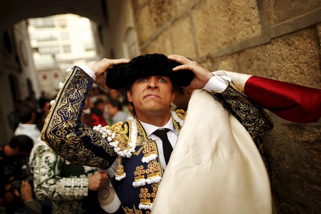 "Spanish bullfighter Julian Lopez ""El Juli"" adjusts his montera (bullfighter's hat) before starting a bullfight at the Malagueta bullring in Malaga, southern Spain, April 4, 2015. (Photo by Jon Nazca/Reuters)"
