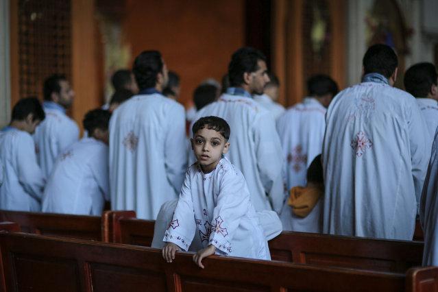 Egyptian Orthodox Christians celebrate Palm Sunday at the Samaan el-Kharaz Church in the Mokattam district of Cairo, Egypt, Sunday, April 5, 2015. (Photo by Mosa'ab Elshamy/AP Photo)