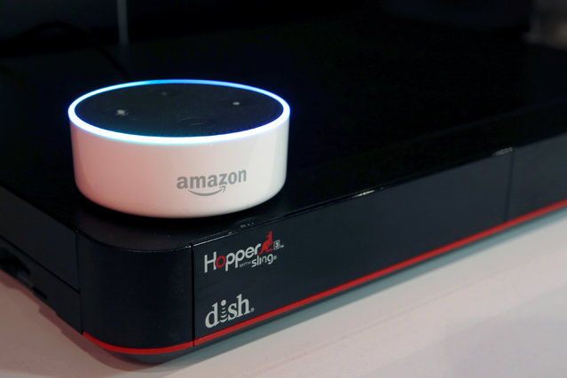 """An Amazon Dot is shown on top of a Hopper at the Dish Network booth during the 2017 CES in Las Vegas, Nevada January 6, 2017. Dish is introducing an """"Ask Hopper Skill"""" that will allow customers to control the Hopper using the Alexa Voice Service. (Photo by Steve Marcus/Reuters)"""