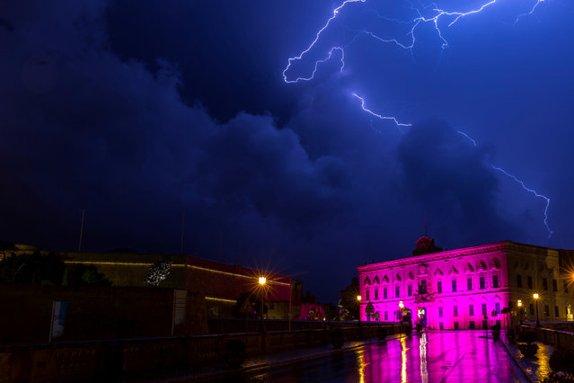 Lightning streaks are seen during a storm over the Auberge de Castille, the office of the Prime Minister Joseph Muscat, in Valletta, Malta, October 19, 2018. (Photo by Darrin Zammit Lupi/Reuters)
