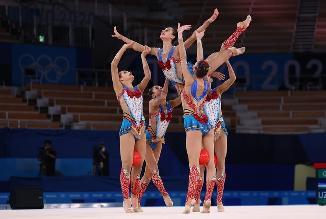 Team Uzbekistan competes in the group all-around qualification of the Rhythmic Gymnastics event during Tokyo 2020 Olympic Games at Ariake Gymnastics centre in Tokyo, on August 7, 2021. (Photo by Mike Blake/Reuters)