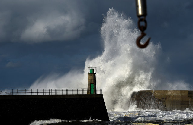 Huge waves crash against a lighthouse in the northern Spanish village of Viavelez, Spain January 13, 2017. (Photo by Eloy Alonso/Reuters)