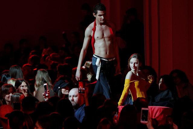 Models present creations by Ukrainian designer Ivan Frolov during Ukrainian Fashion Week in Kiev, Ukraine February 1, 2019. (Photo by Valentyn Ogirenko/Reuters)
