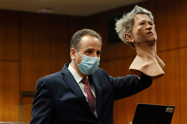 Deputy District Attorney Habib A. Balian holds a rubber latex mask, donned by Robert Durst when police arrested him along with a fake ID and more than $42000 in cash as the prosecution begins the first closing arguments before the jury in the Robert Durst trial for murder as the New York real estate scion who is charged with the longtime friend Susan Bermans killing in Benedict Canyon just before Christmas Eve 2000. Inglewood Courthouse on Wednesday, Sept. 8, 2021 in Inglewood, CA. (Al Seib / Los Angeles Times via Getty Images)