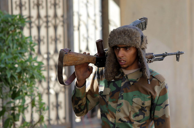 A member of East Libyan forces holds his weapon in Ganfouda district in Benghazi, Libya January 26, 2017. (Photo by Esam Omran Al-Fetori/Reuters)