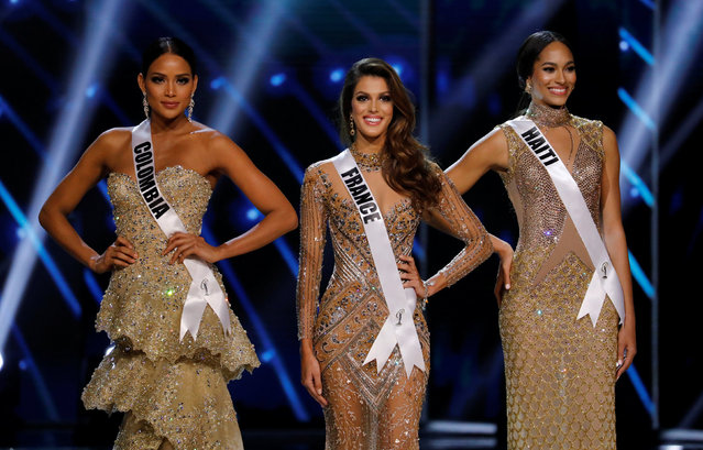 Miss France Iris Mittenaere (C) and other finalists Miss Haiti Jacque Pellisier (R) and Miss Colombia Andrea Tovar pose shortly before Mittenaere wins the 65th Miss Universe beauty pageant at the Mall of Asia Arena, in Pasay, Metro Manila, Philippines January 30, 2017. (Photo by Erik De Castro/Reuters)