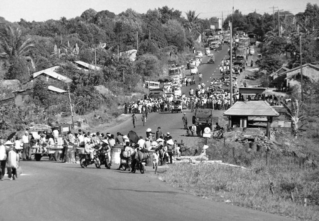 Thousands of South Vietnamese refugees and vehicles of all kinds are at a stand still on Route 1 as they move out of the area with fighting continuing in the Xuan Loc area east of Saigon on Thursday, April 10, 1975. Government forces are battling Communist troops for control of the district town and the strategic main road. (Photo by Nick Ut/AP Photo)