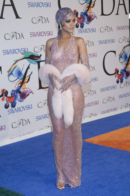 """Rihanna attends the """"2014 CFDA Fashion Awards"""" red carpet arrivals at Alice Tully Hall in New York City.  LAN (Photo by Lars Niki/Corbis via Getty Images)"""