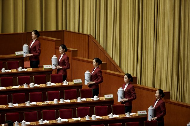 Attendants serve tea ahead of the closing ceremony of the Chinese People's Political Consultative Conference (CPPCC) at the Great Hall of the People, in Beijing, China, March 14, 2016. (Photo by Jason Lee/Reuters)