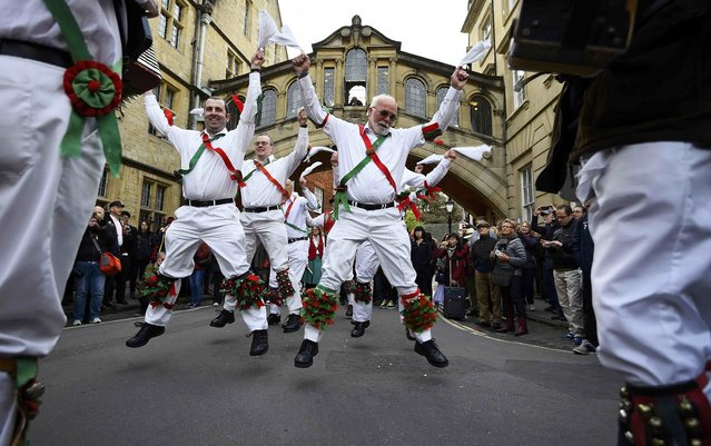 Morris Dancers celebrate beside The Bridge of Sighs in the early hours during traditional May Day celebrations in Oxford, Britain, May 1, 2015. (Photo by Dylan Martinez/Reuters)
