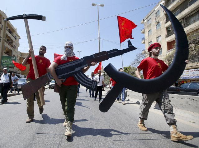 Protestors attend a march organised by the Lebanese Communist party carrying a sickle, hammer and Kalashnikov rifle cut outs to mark Labour Day in Sidon, south Lebanon May 3, 2015. (Photo by Ali Hashisho/Reuters)