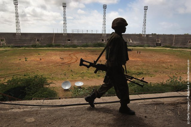 A Ugandan soldier, part of the 9,000-strong African Union Mission in Somalia, (AMISOM) walks through the Banadir soccer stadium in Mogadishu, Somalia