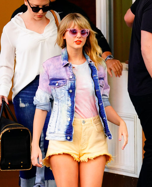Taylor Swift wears a tie-dyed outfit with short shorts when out and about in New York on April 24, 2019. (Photo by Jackson Lee/Splash News and Pictures)