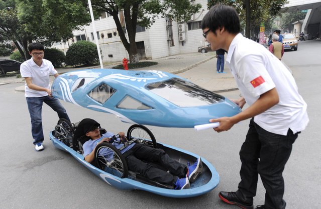 Students open the top of a newly made fuel-efficient vehicle on a street inside Hunan University after a test drive in Changsha, Hunan province October 8, 2013. (Photo by Reuters/Stringer)