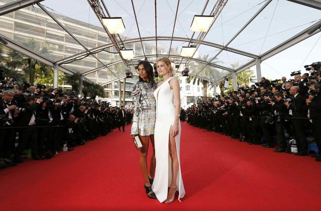 """Model Doutzen Kroes (R) poses on the red carpet as she arrives for the opening ceremony and the screening of the film """"La tete haute"""" out of competition during the 68th Cannes Film Festival in Cannes, southern France, May 13, 2015. (Photo by Regis Duvignau/Reuters)"""