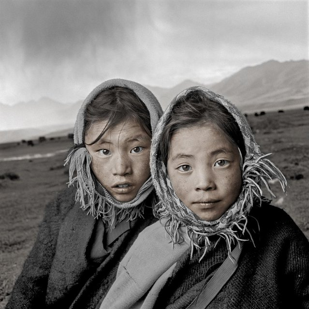 """Tsering and Deckey are good friends whose nomadic families reside in the Yanpachen Valley. I was told that in areas such as this, wildlife was plentiful and virtually unafraid of humans due to the sacred treatment of all life by Tibetan Buddhists. Today wildlife is hard to find and many exotic species have been hunted practically to extinction"". (Phil Borges)"