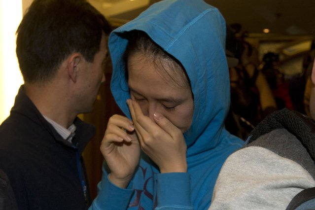 A relative of a Chinese passenger aboard the Malaysia Airlines MH370, cries after being told the latest update in Beijing, China, Monday, March 24, 2014. (Photo by Ng Han Guan/AP Photo)