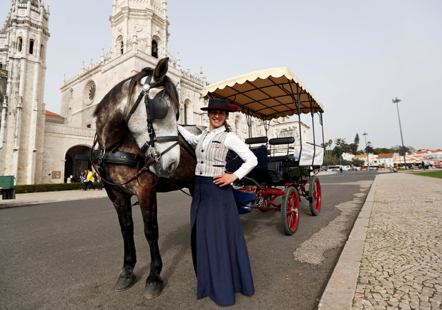 """Gabriela Santos, 26, a driver of carriages for tourists, poses next to Jeronimos monastery in Lisbon, Portugal February 23, 2017. """"In my work it is better to be a woman than a man. Women have more sensitivity with horses. That is why employers prefer to hire women. Also tourists prefer a carriage driven by a woman"""", Santos said. (Photo by Rafael Marchante/Reuters)"""