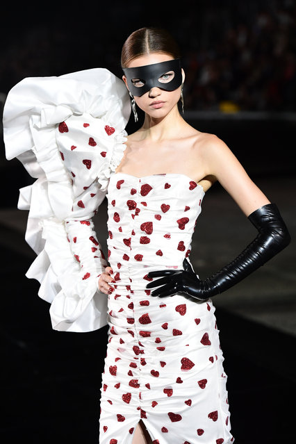 A model presents a creation during the presentation of French fashion editor Carine Roitfeld's CR Runway concept with Italian luxury retailer LuisaViaRoma, on the Piazzale Michelangelo esplanade on June 13, 2019 within the Pitti Immagine Uomo fashion fair in Florence. The show features some 90 fall 2019 men's and women's looks curated by French fashion editor Carine Roitfeld, which will then begin retailing on LuisaViaRoma's international website, rolling out in various drops throughout the year. (Photo by Miguel Medina/AFP Photo)