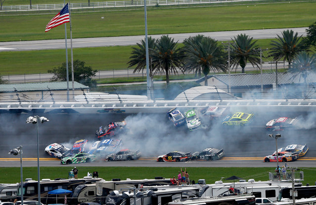 Austin Dillon, driver of the #3 American Ethanol Chevrolet, and Clint Bowyer, driver of the #14 Mobil 1/Rush Truck Centers Ford, start an on-track incident during the Monster Energy NASCAR Cup Series Coke Zero Sugar 400 at Daytona International Speedway on July 07, 2019 in Daytona Beach, Florida. (Photo by Brian Lawdermilk/Getty Images)