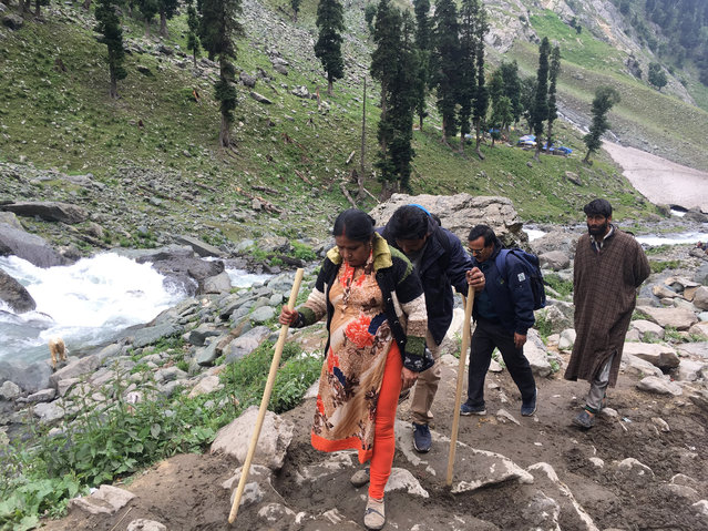 In this Saturday, July 27, 2019, photo, Hindu pilgrims walk uphill as they participate in the annual amarnath pilgrimage near Chandanwa, Indian controlled Kashmir. India is pitching a Hindu pilgrimage to a snowy cave shrine in disputed, Muslim-majority Kashmir as evidence of peace in a state marred by decades of armed conflict amid popular resistance to Indian rule. The annual yatra, or spiritual journey, to the Amarnath shrine, the hallowed mountain cave where devotees revere an icy stalagmite as an image of Lord Shiva, presents an opportunity for the state of Jammu and Kashmir to show something beyond the frequent skirmishes between armed separatists and Indian soldiers that have cost tens of thousands of lives. (Photo by Emily Schmall/AP Photo)