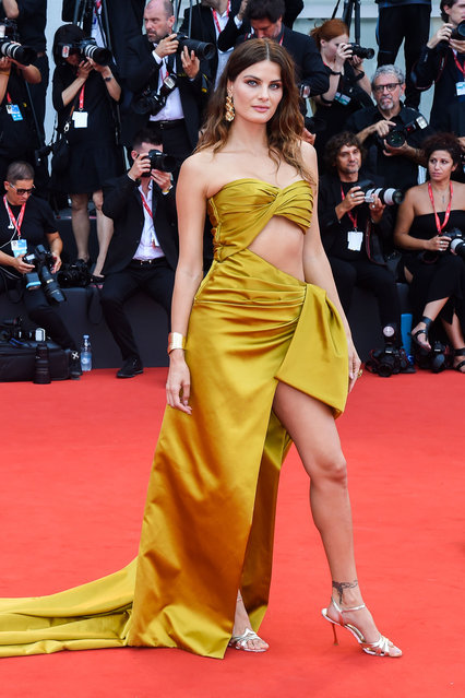 Isabeli Fontana walks the red carpet ahead of the opening ceremony during the 76th Venice Film Festival at Sala Casino on August 28, 2019 in Venice, Italy. (Photo by Stephane Cardinale – Corbis/Corbis via Getty Images)