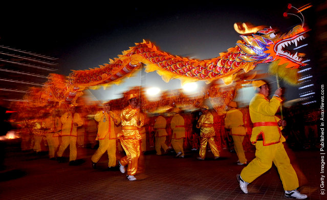 People perform the Dragon Dance to celebrate the Lantern Festival
