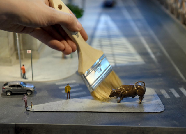 A miniature model of the Wall Street Bull in New York, part of Gulliver's Gate, a miniature world being recreated in a 49,000-square-foot exhibit space in Times Square, is seen during a preview April 10, 2017. (Photo by Timothy A. Clary/AFP Photo)