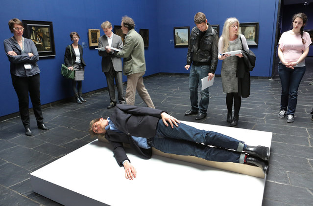"""A artist Erwin Wurm """"One Minute sculpture"""" the Staedel Museum on May 6, 2014 in Frankfurt am Main, Germany.  (Photo by Hannelore Foerster/Getty Images)"""