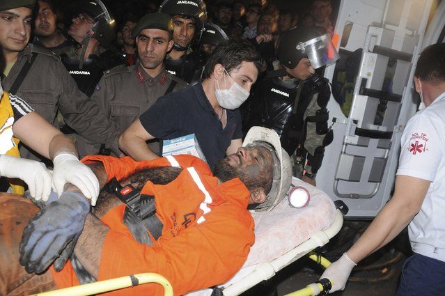 An injured miner is carried to an ambulance in Soma, a district in Turkey's western province of Manisa May 13, 2014. An explosion and fire in the coal mine in western Turkey killed at least seventeen miners on Tuesday and may have trapped as many as 300 more, officials said. (Photo by Reuters/Depo Photos)