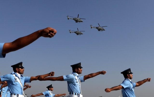 Indian Air Force (IAF) soldiers march as advanced light helicopters fly during the Indian Air Force Day celebrations at the Hindon Air Force Station on the outskirts of New Delhi, India, October 8, 2019. (Photo by Anushree Fadnavis/Reuters)