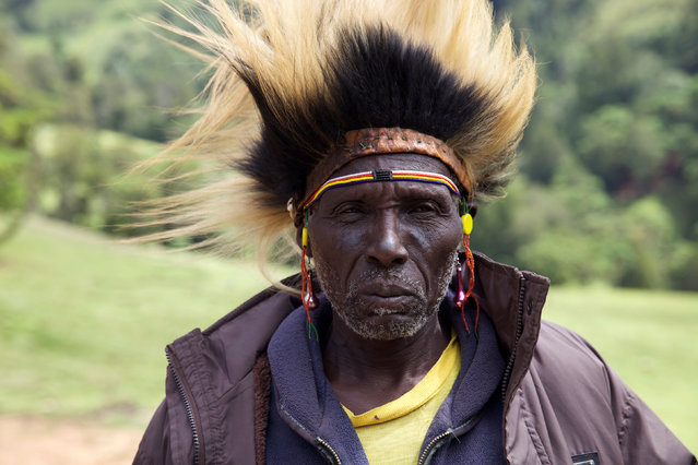 A man from the Sengwer community poses for a photograph after protesting over their eviction from their ancestral lands, Embobut Forest, by the government for forest conservation in western Kenya, April 19, 2016. (Photo by Katy Migiro/Reuters)