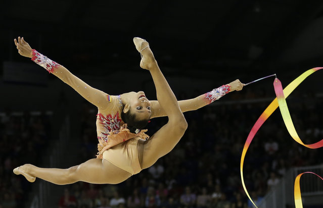 Venezuela's Grisbel Lopez performs with the ribbon during individual all-around rhythmic gymnastics competition in the Pan Am Games in Toronto Saturday, July 18, 2015. (Photo by Gregory Bull/AP Photo)