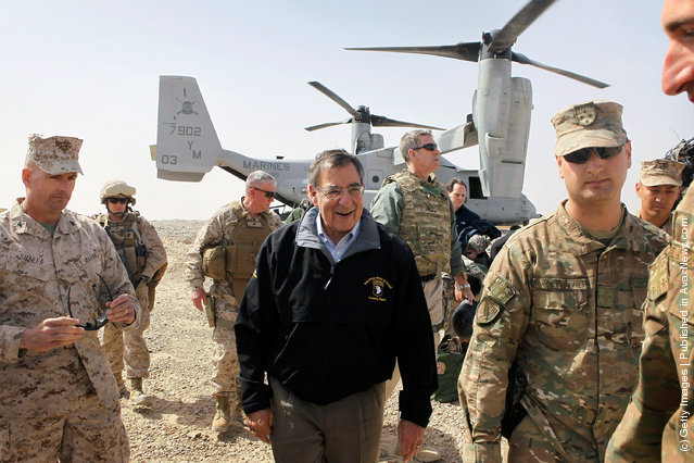 U.S. Secretary of Defense Leon Panetta (C) is greeted after arriving to greet troops March 14, 2012 at Foward Operating Base Shukvani, Afghanistan