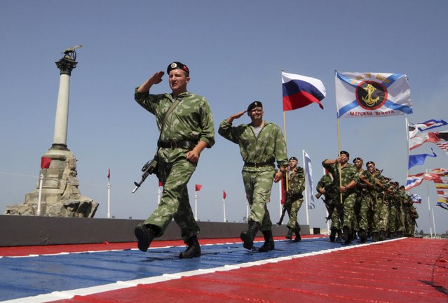 Russian servicemen march during celebrations for Navy Day in the Black Sea port of Sevastopol, Crimea, July 26, 2015. (Photo by Pavel Rebrov/Reuters)