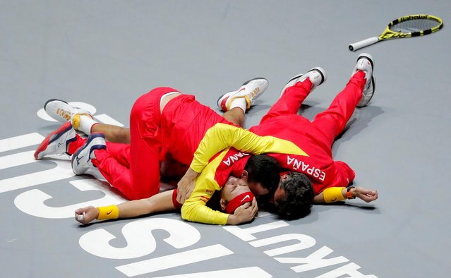 Spain's Rafael Nadal celebrates with teammates after winning against Canada's Denis Shapovalov during the final singles tennis match between Canada and Spain at the Davis Cup Madrid Finals 2019 in Madrid on November 24, 2019. (Photo by Susana Vera/Reuters)