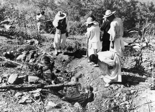The scene after North Korean police massacred 300 South Korean civilians at Changa-Pa, 1950