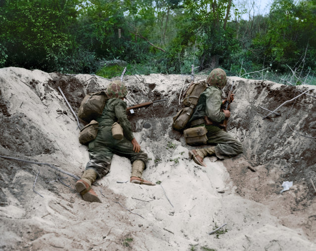 Two Marines take cover in shell hole on Saipain, June, 1944. (Photo by Jared Enos/Mediadrumworld.com)