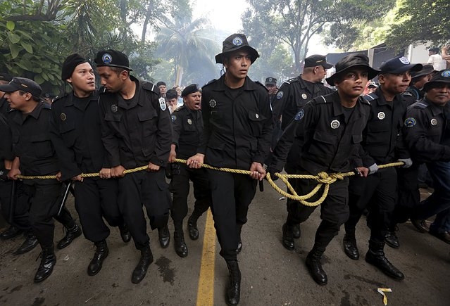Members of the National Police safeguard the festivities in honour to the patron saint of Managua, Santo Domingo de Guzman, in Managua, Nicaragua, August 1, 2015. (Photo by Oswaldo Rivas/Reuters)