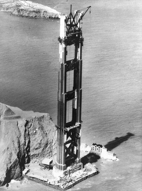 One of the stanchions erected in the building of the Golden Gate bridge, connecting Marin and San Francisco, casts a shadow over houses at its foot, circa 1935. (Photo by General Photographic Agency/Getty Images)