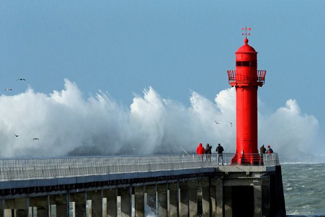 Waves crash against a pier during a windy day in Boulogne-sur-Mer, France, February 9, 2019. (Photo by Pascal Rossignol/Reuters)